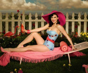 Katy Perry Lying On Chair Body Figure Wallpaper